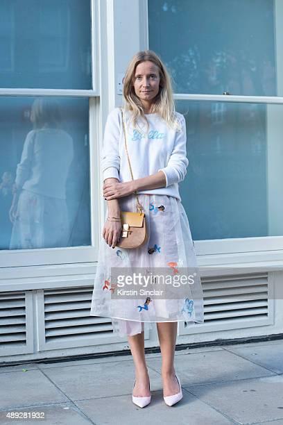 TV presenter Martha Ward wears Nicholas Kirkwood shoes Alexander Lewis sweater and skirt Chloe bag and Zanzan sunglasses on day 2 during London...
