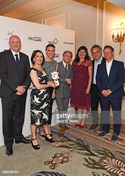 Presenter Martin Freeman poses with Mike Bartlett Roanna Benn Suranne Jones Jude Liknaitzky Greg Brenman and Neil Stuke accepting the TV Drama award...
