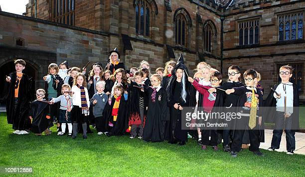 Presenter Maude Garrett poses with young Harry Potter fans at the LEGO Harry Potter Open Day at Sydney University on July 4 2010 in Sydney Australia...