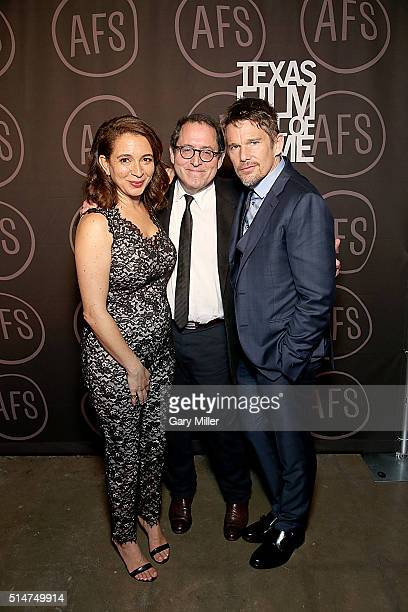 Presenter Maya Rudolph honoree Michael Barker and presenter Ethan Hawke pose back stage during the Austin Film Society's 2016 Texas Film Awards at...