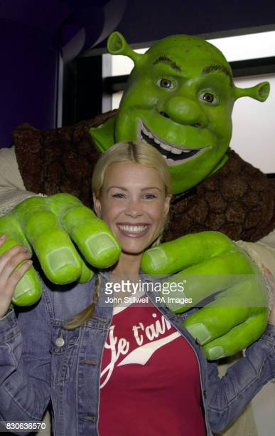 TV presenter Melinda Messenger gets a hug from the star of 'Shrek' at a celebrity screening of the new animated film from the Dreamworks studio at...