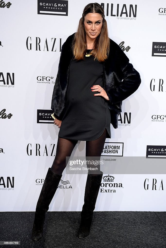 Presenter <a gi-track='captionPersonalityLinkClicked' href=/galleries/search?phrase=Melissa+Satta&family=editorial&specificpeople=2083016 ng-click='$event.stopPropagation()'>Melissa Satta</a>, girlfriend from Schalke's footballer Kevin-Prince Boateng, shows her pregnancy prior to the Milian by Annette Goertz show during Platform Fashion Dusseldorf on February 1, 2014 in Dusseldorf, Germany.
