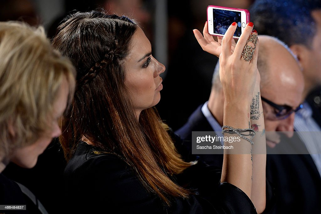 Presenter Melissa Satta, girlfriend from Schalke's footballer Kevin-Prince Boateng, photographs with her smartphone during the Milian by Annette Goertz show during Platform Fashion Dusseldorf on February 1, 2014 in Dusseldorf, Germany.