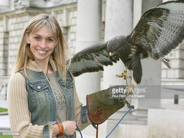 TV presenter Michaela Strachan with a buzzard at Belfast City Hall to launch a unique tourist guide inviting locals and visitors to 'walk on the wild...
