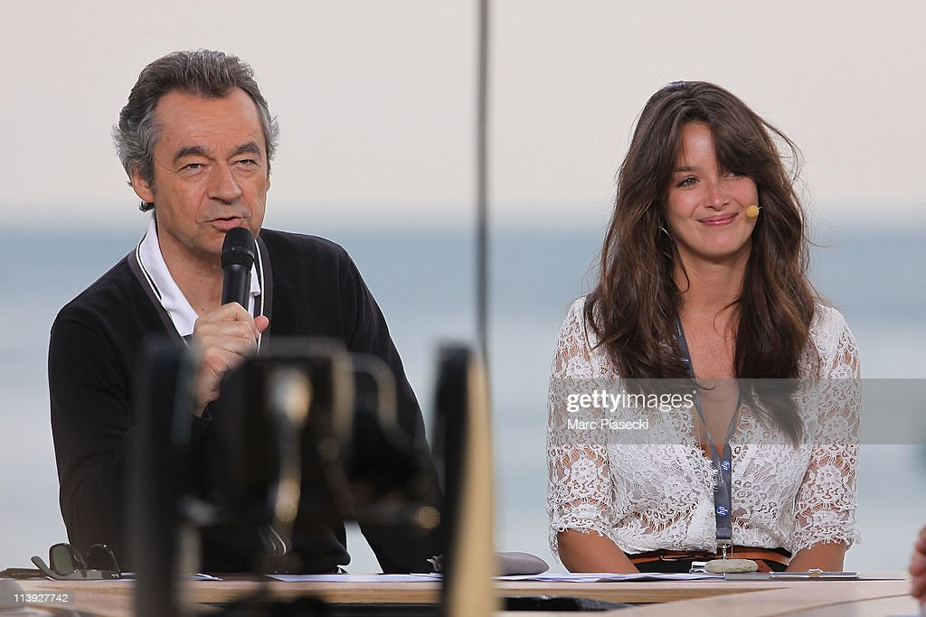 TV presenter Michel Denisot and TV journalist Charlotte Le Bon attend the 'Le Grand Journal' daily show rehearsal on May 10, 2011 in Cannes, France.