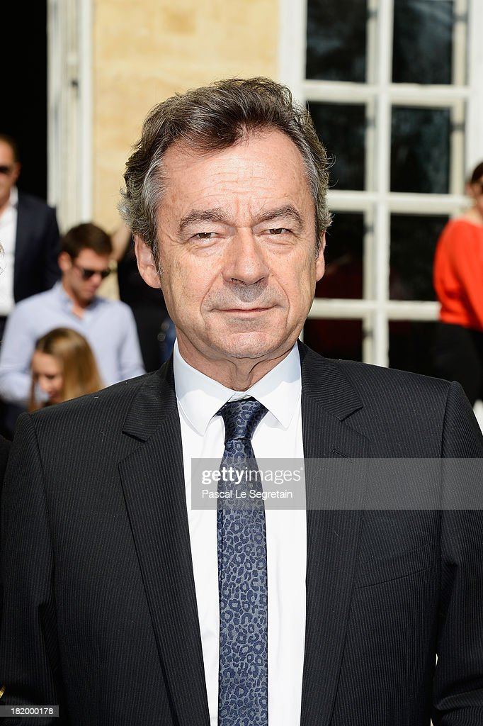 TV presenter <a gi-track='captionPersonalityLinkClicked' href=/galleries/search?phrase=Michel+Denisot&family=editorial&specificpeople=753821 ng-click='$event.stopPropagation()'>Michel Denisot</a> arrives at the Christian Dior show as part of the Paris Fashion Week Womenswear Spring/Summer 2014 at Musee Rodin on September 27, 2013 in Paris, France.