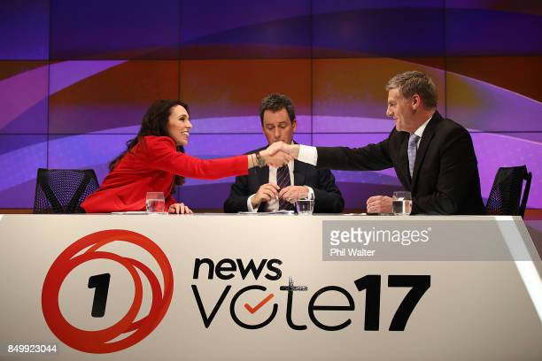 Presenter Mike Hosking chairs the TVNZ leaders debate as Labour Leader Jacinda Ardern and Prime Minister Bill English shake hands following the Vote...