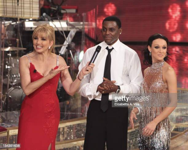 Presenter Milly Carlucci Carl Lewis and dancer Nancy Berti appears on the Italian TV show 'Ballando Con Le Stelle' at RAI Auditorium on January 9...