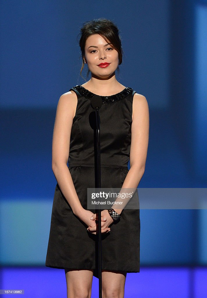 Presenter Miranda Cosgrove speaks onstage during the CNN Heroes: An All Star Tribute at The Shrine Auditorium on December 2, 2012 in Los Angeles, California. 23046_006_MB_1028.JPG