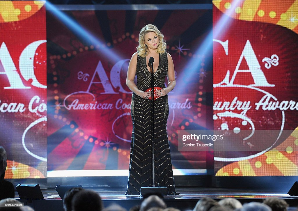 Presenter <a gi-track='captionPersonalityLinkClicked' href=/galleries/search?phrase=Miranda+Lambert&family=editorial&specificpeople=571972 ng-click='$event.stopPropagation()'>Miranda Lambert</a> speaks onstage during the 2011 American Country Awards at MGM Grand Garden Arena on December 5, 2011 in Las Vegas, Nevada.