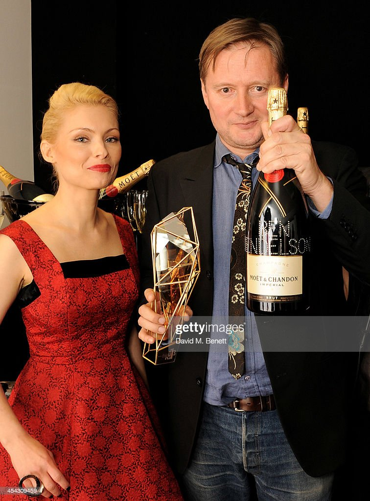 Presenter MyAnna Buring (L) and director David Mackenzie, accepting on behalf of Best Supporting Actor winner Ben Mendelsohn, pose backstage at the Moet British Independent Film Awards 2013 at Old Billingsgate Market on December 8, 2013 in London, England.