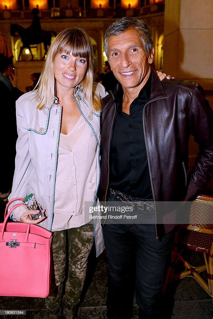 TV presenter <a gi-track='captionPersonalityLinkClicked' href=/galleries/search?phrase=Nagui&family=editorial&specificpeople=765035 ng-click='$event.stopPropagation()'>Nagui</a> and his wife actress Melanie Page attend 'Nina' : Premiere at Theatre Edouard VII on September 16, 2013 in Paris, France.