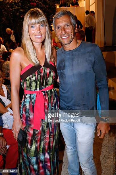 Presenter Nagui with his wife actress Melanie Page attend the 30th Ramatuelle Festival Day 7 on August 7 2014 in Ramatuelle France
