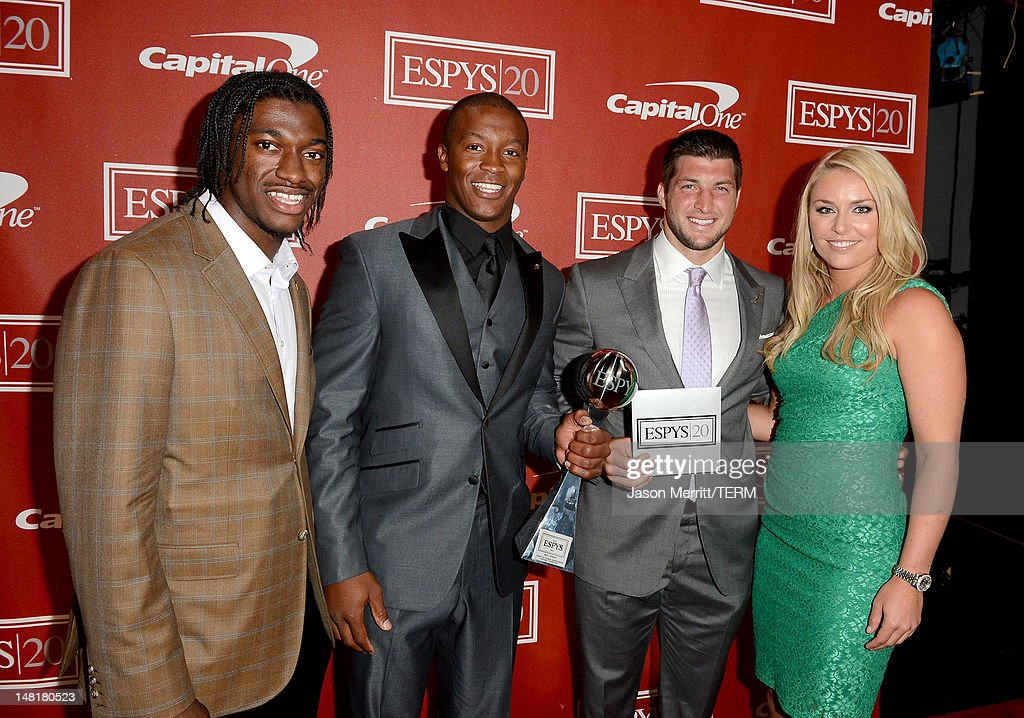 Presenter NFL player <a gi-track='captionPersonalityLinkClicked' href=/galleries/search?phrase=Robert+Griffin&family=editorial&specificpeople=2495030 ng-click='$event.stopPropagation()'>Robert Griffin</a> III of the Washington Redskins, NFL player <a gi-track='captionPersonalityLinkClicked' href=/galleries/search?phrase=Demaryius+Thomas&family=editorial&specificpeople=4536795 ng-click='$event.stopPropagation()'>Demaryius Thomas</a> and <a gi-track='captionPersonalityLinkClicked' href=/galleries/search?phrase=Tim+Tebow&family=editorial&specificpeople=2729658 ng-click='$event.stopPropagation()'>Tim Tebow</a> of the New York Jets, (winners of the Best Moment Award) and Olympic gold medalist <a gi-track='captionPersonalityLinkClicked' href=/galleries/search?phrase=Lindsey+Vonn&family=editorial&specificpeople=4668171 ng-click='$event.stopPropagation()'>Lindsey Vonn</a> pose backstage during the 2012 ESPY Awards at Nokia Theatre L.A. Live on July 11, 2012 in Los Angeles, California.