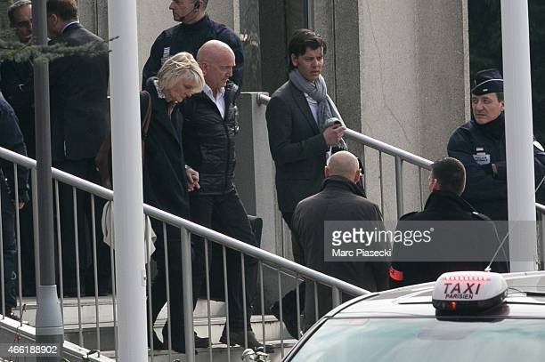 Presenter of the French reality show 'Dropped' Louis Bodin and wife Claire DepeuilleBodin leave the the Honours Pavilion at CharlesdeGaulle airport...