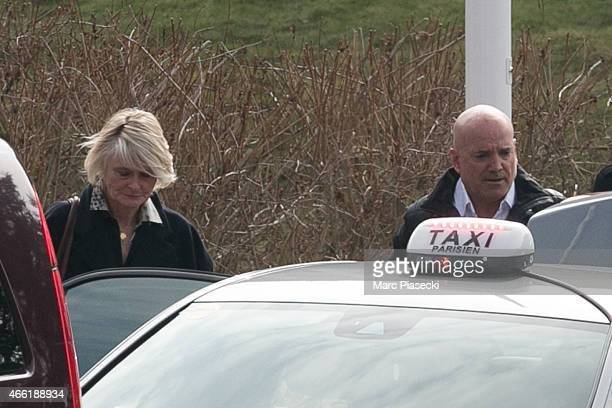Presenter of the French reality show 'Dropped' Louis Bodin and wife Claire DepeuilleBodin leave the Honours Pavilion at CharlesdeGaulle airport on...