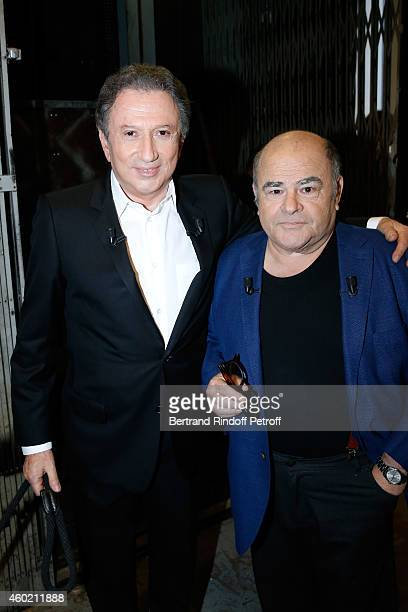 Presenter of the show Michel Drucker and Actor Jean Benguigui who presents his book 'Un parfum d'orange amere' during the 'Vivement Dimanche' French...