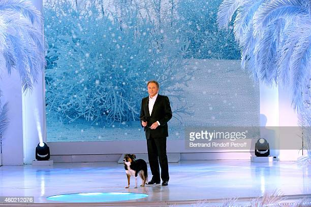 Presenter of the show Michel Drucker and his dog attend the 'Vivement Dimanche' French TV Show at Pavillon Gabriel on December 9 2014 in Paris France