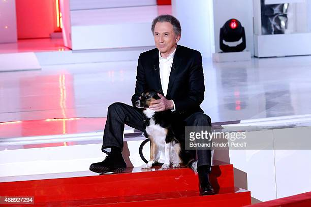 Presenter of the show Michel Drucker and his dog attend the 'Vivement Dimanche' French TV Show at Pavillon Gabriel on April 8 2015 in Paris France