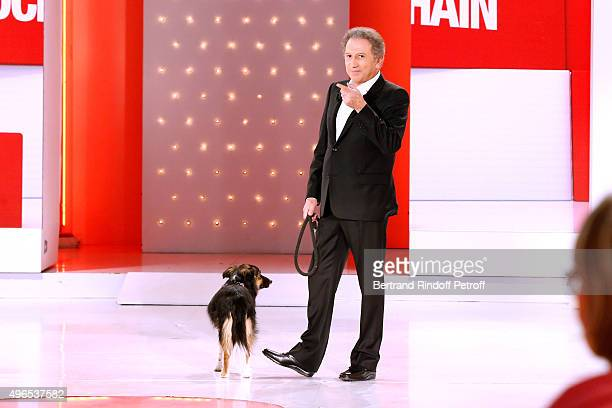 Presenter of the Show Michel Drucker and his dog Isia attend the 'Vivement Dimanche' French TV Show at Pavillon Gabriel on November 10 2015 in Paris...