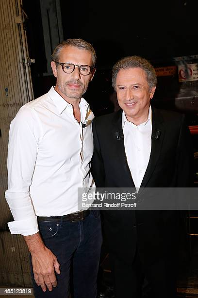 Presenter of the show Michel Drucker and main guest of the show actor Lambert Wilson who presents the movie 'Barbecue' attend the 'Vivement Dimanche'...