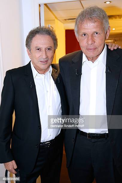 Presenter of the Show Michel Drucker and Main Guest of the Show Journalist Patrick Poivre d'Arvor attend the 'Vivement Dimanche' French TV Show at...