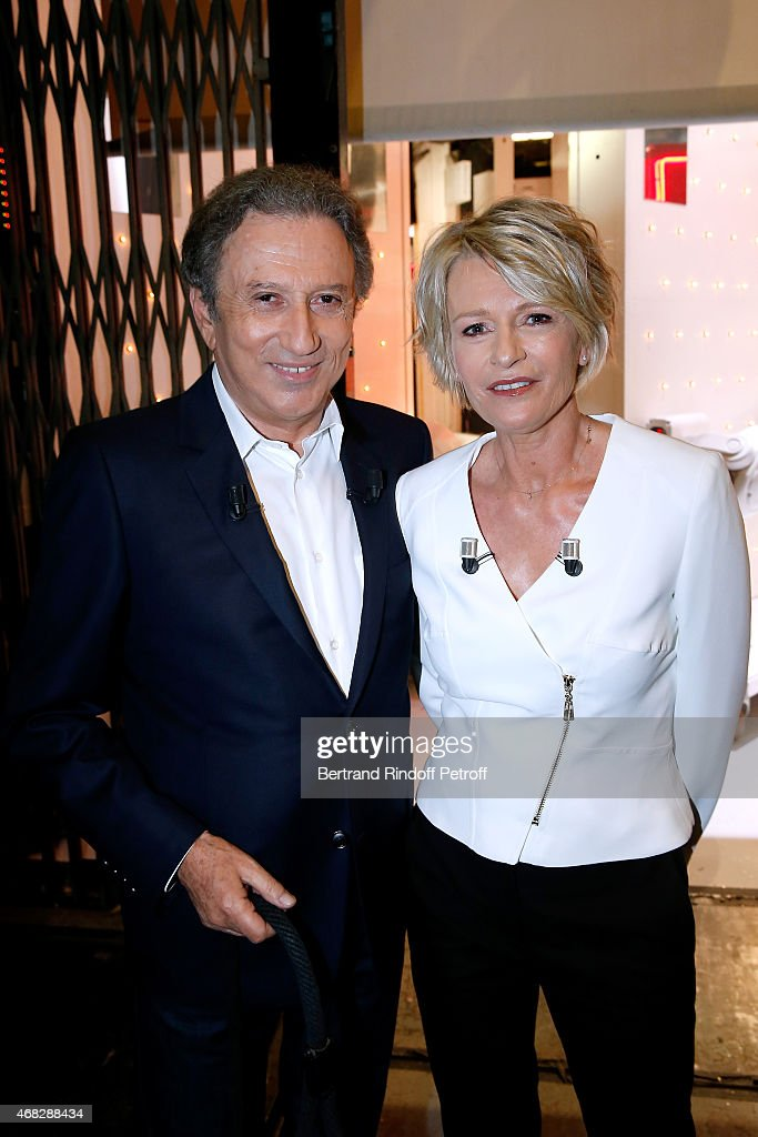 Presenter of the show Michel Drucker and Main Guest of the show, TV Host Sophie Davant attend the 'Vivement Dimanche' French TV Show at Pavillon Gabriel on April 1, 2015 in Paris, France.