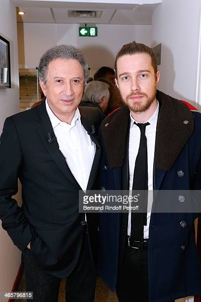 Presenter of the show Michel drucker and singer Julien Dore attend the 'Vivement Dimanche' French TV show at Pavillon Gabriel on January 29 2014 in...