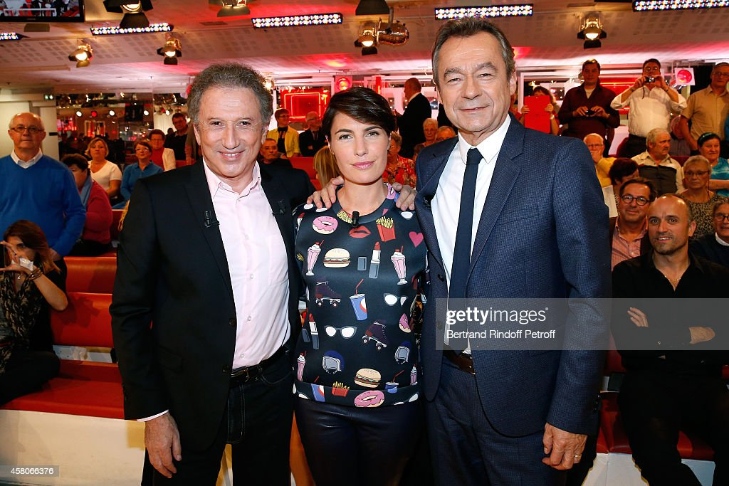 Presenter of the show Michel Drucker, Journalist Alessandra Sublet who presents her TV show 'Un soir à la tour eiffel' and Chief Editor of Vanity Fair France, Michel Denisot who presents his book 'Breves de vies' attend the 'Vivement Dimanche' French TV Show. Held at Pavillon Gabriel on October 29, 2014 in Paris, France.