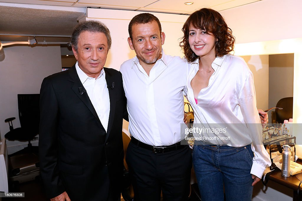 Presenter of the show Michel Drucker, Main Guest of the show, humorist Dany Boon and actress Valerie Bonneton, both from movie 'Eyjafjallajokull', attend 'Vivement Dimanche' French TV Show at Pavillon Gabriel on September 18, 2013 in Paris, France.