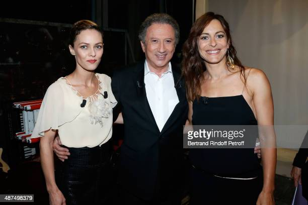 Presenter of the show Michel Drucker standing between main guest of the show singer and actress Vanessa Paradis and director Audrey Dana They present...