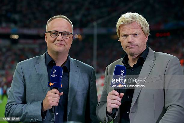 TV presenter Oliver Welke looks on with TV expert Oliver Kahn prior to the UEFA Champions League Group E match between Bayern Munchen and Manchester...