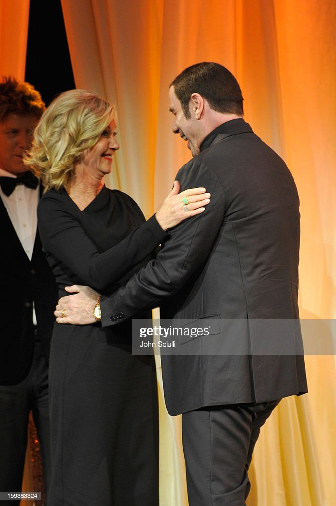 Presenter Olivia Newton-John presents honoree <a gi-track='captionPersonalityLinkClicked' href=/galleries/search?phrase=John+Travolta&family=editorial&specificpeople=178204 ng-click='$event.stopPropagation()'>John Travolta</a> with the Goodwill Ambassador for Australia award onstage during the 2013 G'Day USA Los Angeles Black Tie Gala at JW Marriott Los Angeles at L.A. LIVE on January 12, 2013 in Los Angeles, California.