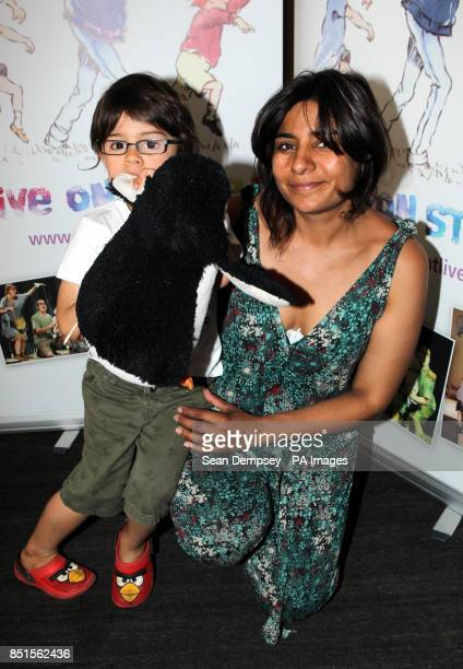 CBBC presenter Rani Price and son Rudy aged four and a half attending a special performance show of We're Going On A Bear Hunt at the Lyric Theatre