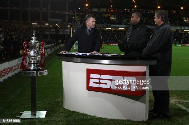 ESPN presenter Ray Stubbs talks to pundits John Barnes and Gary Mabbutt at halftime