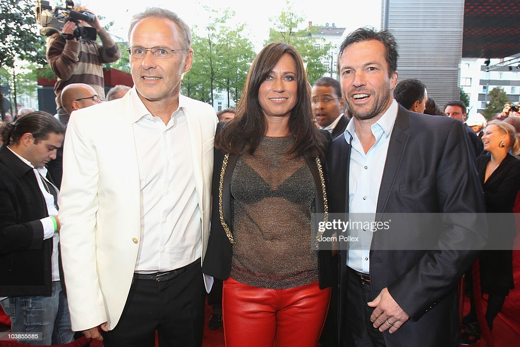 Presenter Reinhold Beckmann and his wife Kerstin and Lothar Matthaeus attend the Day of Legends gala Night of Legends at the Schmitz Tivoli theatre...