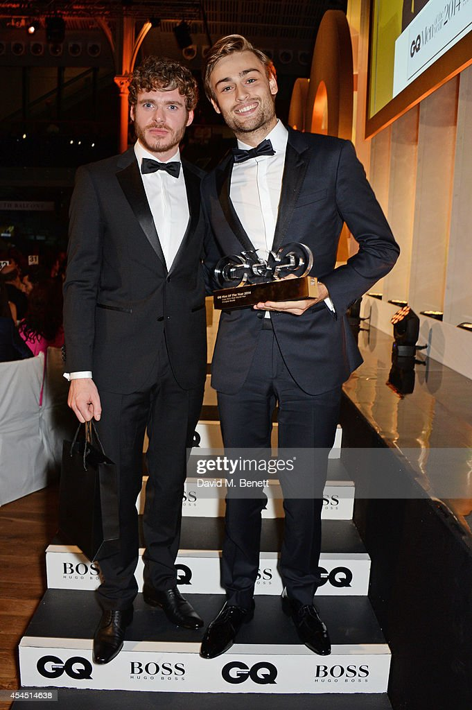 Presenter <a gi-track='captionPersonalityLinkClicked' href=/galleries/search?phrase=Richard+Madden&family=editorial&specificpeople=8954998 ng-click='$event.stopPropagation()'>Richard Madden</a> (L) and <a gi-track='captionPersonalityLinkClicked' href=/galleries/search?phrase=Douglas+Booth&family=editorial&specificpeople=6324411 ng-click='$event.stopPropagation()'>Douglas Booth</a>, winner of the Hugo Boss most Stylish Man award, attend the GQ Men Of The Year awards in association with Hugo Boss at The Royal Opera House on September 2, 2014 in London, England.