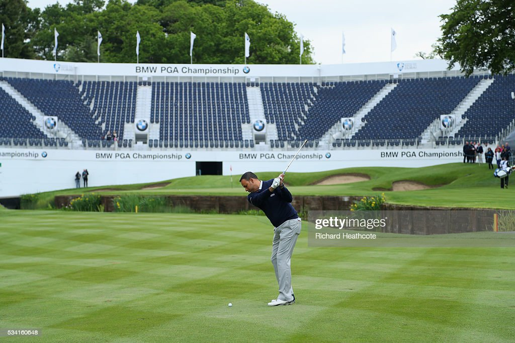 Presenter Rishi Persad plays into the 18th green during the Pro-Am prior to the BMW PGA Championship at Wentworth on May 25, 2016 in Virginia Water, England.