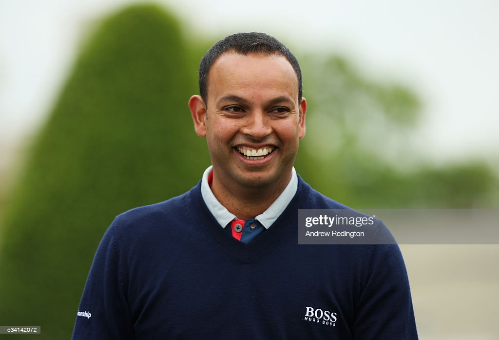 Presenter Rishi Persad smiles during the Pro-Am prior to the BMW PGA Championship at Wentworth on May 25, 2016 in Virginia Water, England.