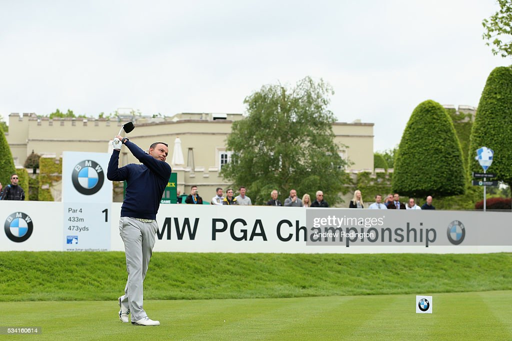 Presenter Rishi Persad tees off on the 1st hole during the Pro-Am prior to the BMW PGA Championship at Wentworth on May 25, 2016 in Virginia Water, England.