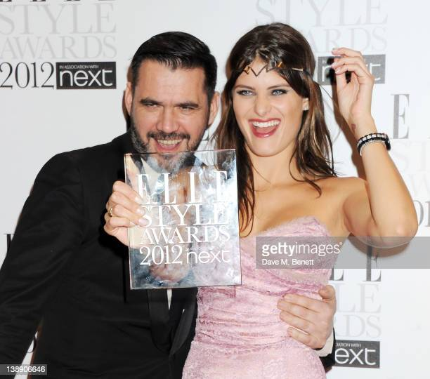 Presenter Roland Mouret and Best Model winner Isabeli Fontana pose in the press room at the ELLE Style Awards at The Savoy Hotel on February 13 2012...