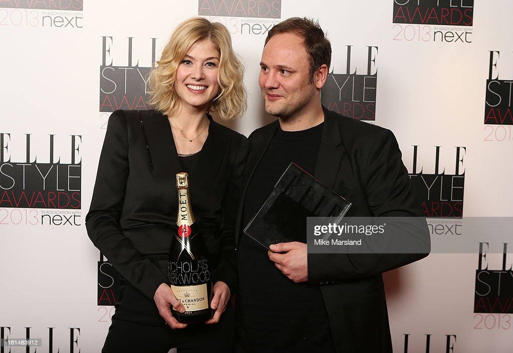 Presenter Rosamund Pike and Best Accessory Designer of the Year Nicholas Kirkwood pose in the press room at the Elle Style Awards at The Savoy Hotel on February 11, 2013 in London, England.
