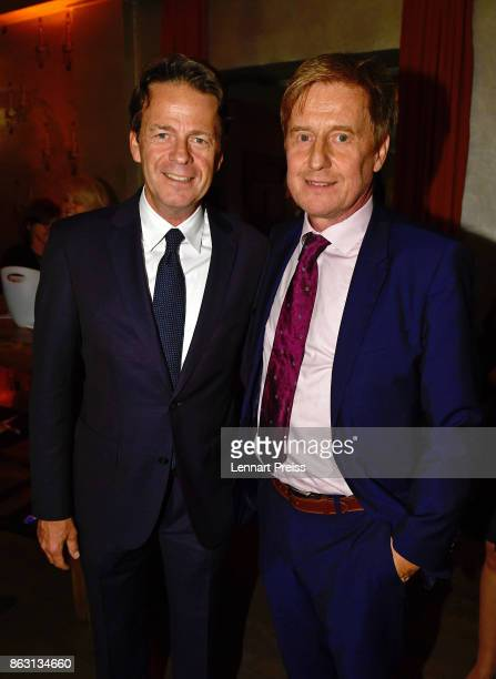 TV presenter Rudi Cerne and producer Martin Gross pose during the 'Aktenzeichen XY ungeloest' 50th anniversary celebration at Park Cafe on October 19...