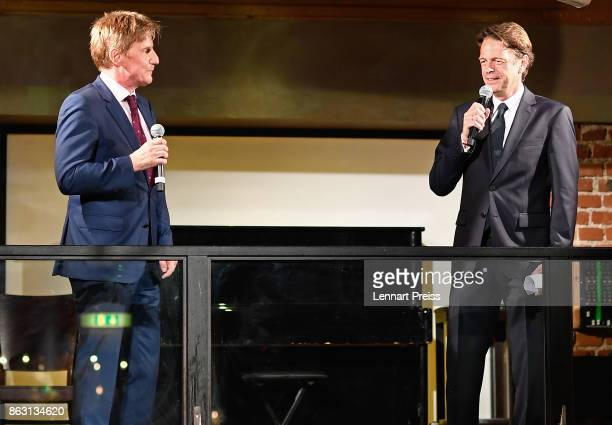 TV presenter Rudi Cerne and producer Martin Gross speak during the 'Aktenzeichen XY ungeloest' 50th anniversary celebration at Park Cafe on October...