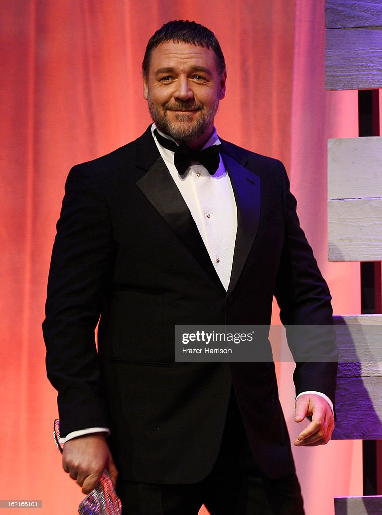 Presenter <a gi-track='captionPersonalityLinkClicked' href=/galleries/search?phrase=Russell+Crowe&family=editorial&specificpeople=202609 ng-click='$event.stopPropagation()'>Russell Crowe</a> speaks onstage during the 15th Annual Costume Designers Guild Awards with presenting sponsor Lacoste at The Beverly Hilton Hotel on February 19, 2013 in Beverly Hills, California.