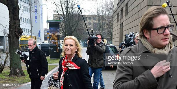 TV presenter Sabine Christiansen exits together with friend filmproducer David Groenewold through the back entrace of the Landgericht Hannover...