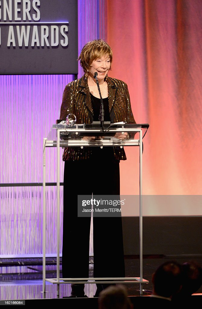 Presenter <a gi-track='captionPersonalityLinkClicked' href=/galleries/search?phrase=Shirley+MacLaine&family=editorial&specificpeople=204788 ng-click='$event.stopPropagation()'>Shirley MacLaine</a> onstage during the 15th Annual Costume Designers Guild Awards with presenting sponsor Lacoste at The Beverly Hilton Hotel on February 19, 2013 in Beverly Hills, California.