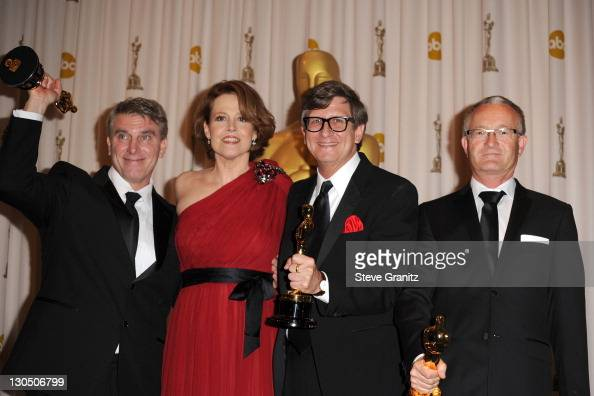 Presenter Sigourney Weaver poses with Art Directors Robert Stromberg Rick Carter Kim Sinclair in the press room at the 82nd Annual Academy Awards...