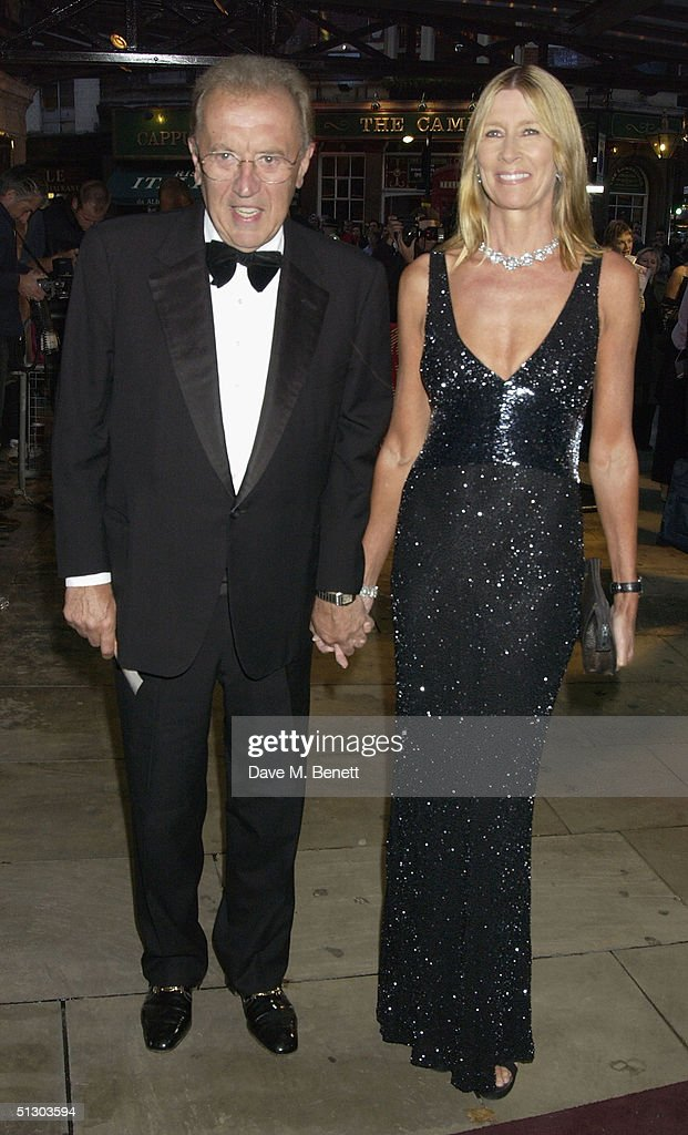 TV presenter Sir David Frost and his wife Carina attend the Royal Gala Premiere of Lord Andrew Lloyd Webber's new musical 'The Woman In White' at the Palace Theatre, Shaftesbury Avenue on September 13, 2004 in London.