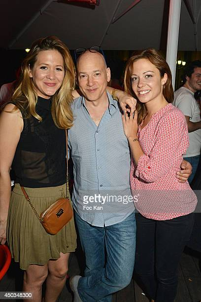 TV presenter Stephanie Loire comedians Evan Handler and Dounia Coesens attend 'La Boumette' Party at L'Opera Restaurant on June 7 2014 in Paris France